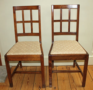 <p>Pair of good quality antique Arts & Crafts oak lattice back dining chairs by Heals.</p>