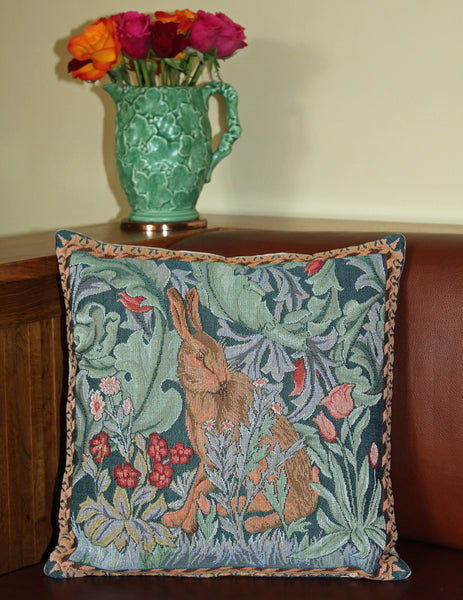 <p>Fine quality cotton jacquard woven tapestry cushion with beige velvet back in William Morris The Hare - facing right - design. Has a concealed zip fastener and removable feather pad.</p>