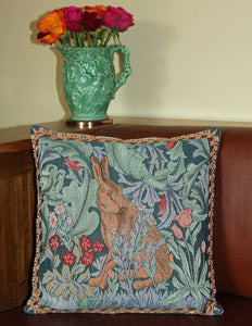 <p>Fine quality cotton jacquard woven large tapestry cushion cover with beige velvet back in William Morris The Hare - facing right - design. Has a concealed zip fastener.</p>