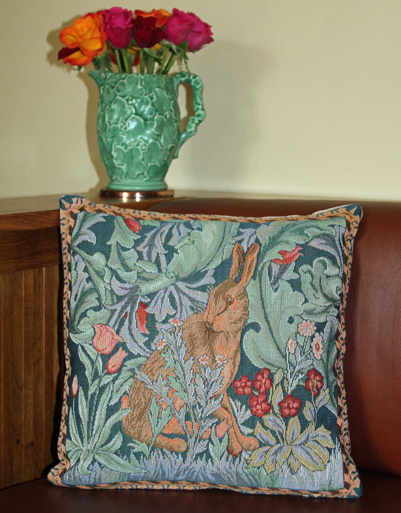 <p>Fine quality cotton jacquard woven large tapestry cushion with beige velvet back in William Morris The Hare - facing left - design. Has a concealed zip fastener and removable feather pad.</p>