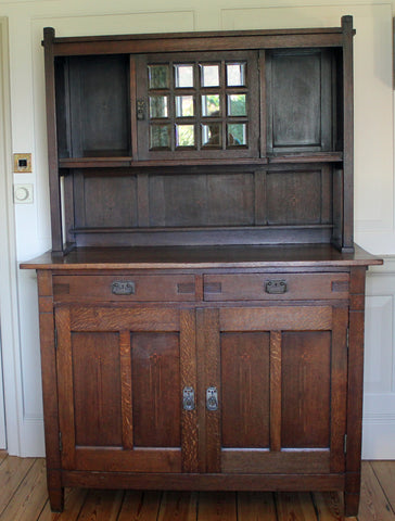 <p>Antique Arts & Crafts oak sideboard circa 1900. Solid, heavy piece with glazed cupboard on the top section.</p>