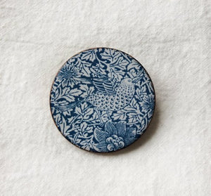 <p>Beautiful handmade ceramic brooch in the Bird & Anemone design by William Morris.</p>