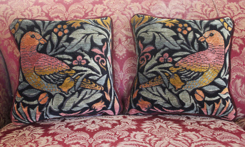 <p>Pair of fine quality cotton jacquard woven tapestry cushions with burgundy chenille back adapted from William Morris's Bird design. Has a concealed zip fastener and removable feather pad.</p>