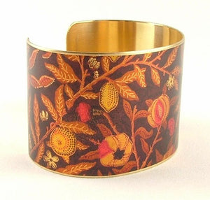 <p>Beautiful adjustable brass cuff bracelet with the Fruit or Pomegrante design by William Morris.</p>