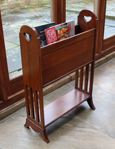 <p>Antique Arts & Crafts oak magazine stand with attractive heart cut outs and inlay.</p>