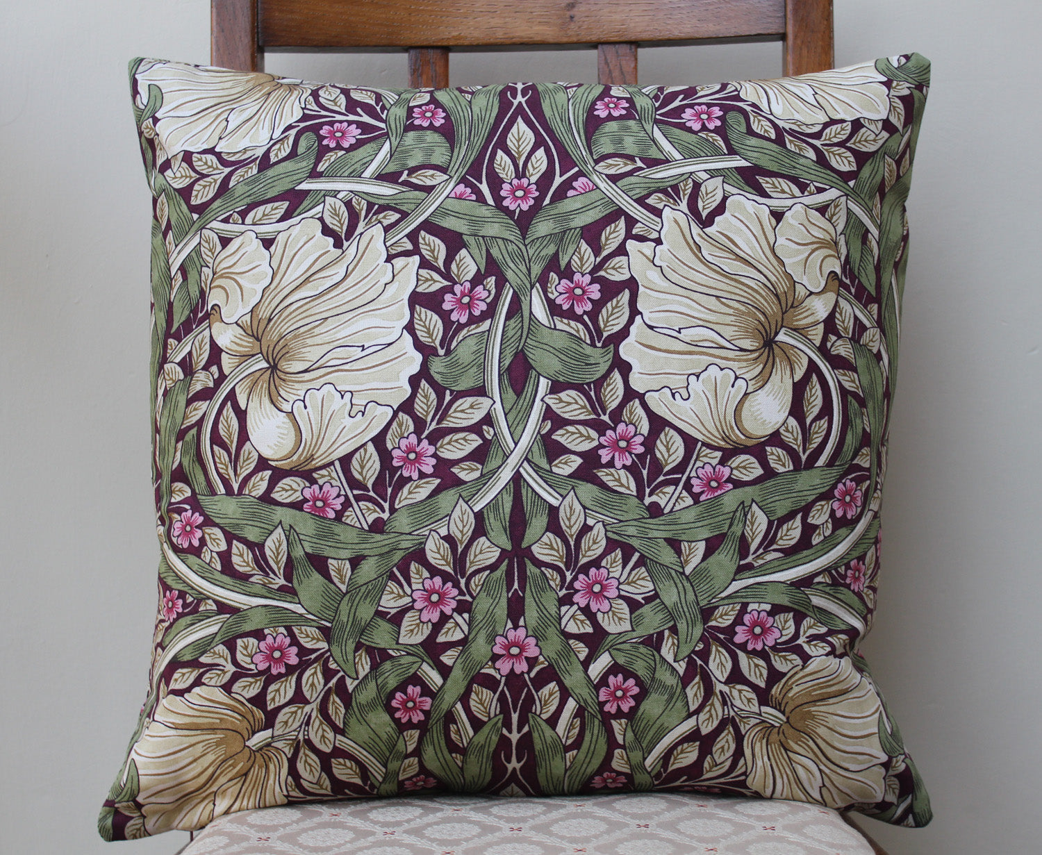 <p>Cotton filled cushion in William Morris Pimpernel Aubergine print made from Morris & Co. Sanderson fabric.</p>