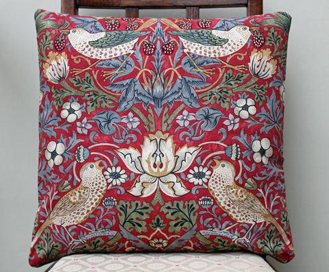 <p>Cushion with duck feather inner pad in William Morris Strawberry Thief crimson print. Morris & Co. by Sanderson fabric.</p>