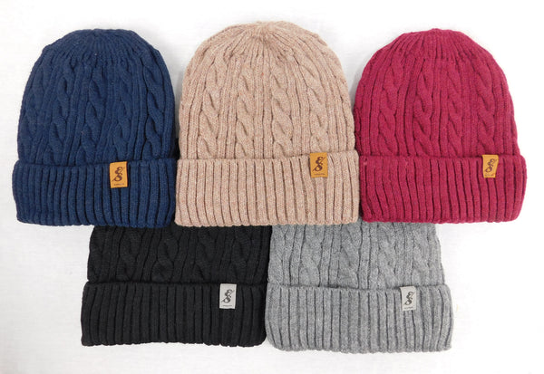 The Matterhorn Wool Cable Knit Beanie with faux fur lining
