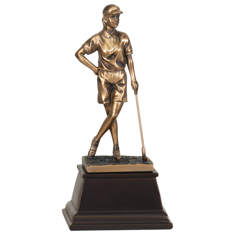 Medium sized bronze golf trophy on a tapered square dark wood base. The bronze female golfer is standing with her legs grossed and one hand on her hip and the other hand leaning on a golf club. She is staring off into the distance with a visor on.
