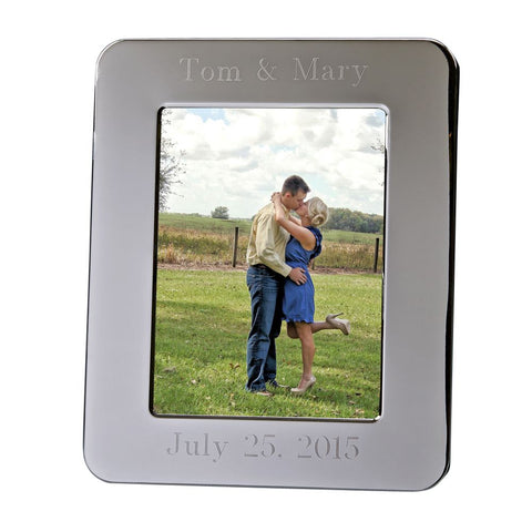 "Shiny silver picture frame with rounded edges. Holds an 8"" x 10"" photo. The top of the picture frame is engraved to read ""Tom & Mary"". The bottom reads ""July 25, 2015"""