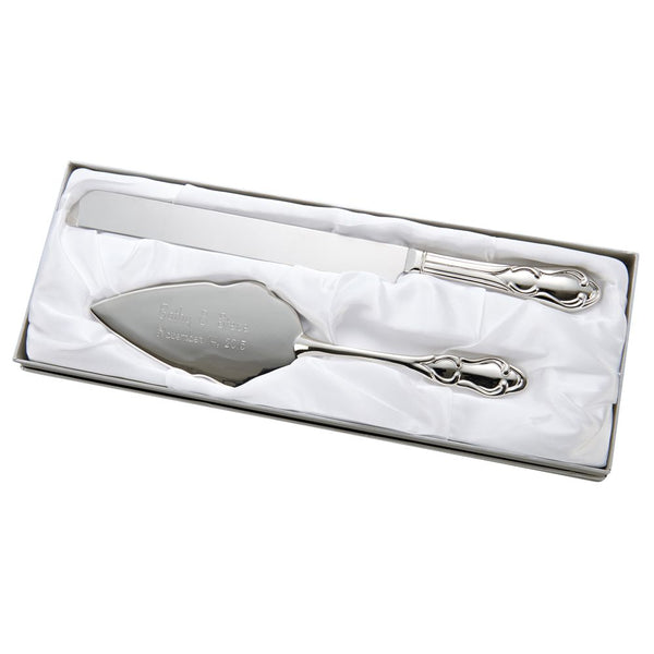 Shiny silver metal cake server and knife set featuring a thick ornate design at the bottom of the handles. The cake server is engraved with the bride and groom's names and wedding date.