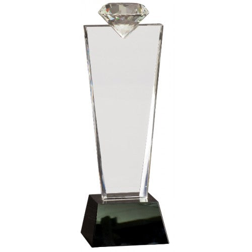 Engraved crystal award featuring a tapered square black glass base, and a thick tapered rectangle shaped crystal body with a diamond shape sitting on top.