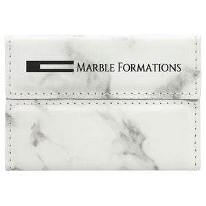 White and grey marble print business card holder engraved with a company logo in black.