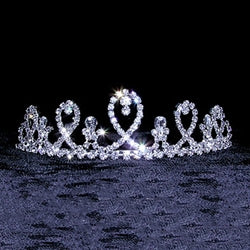 Small rhinestone tiara that resembles ribbon.
