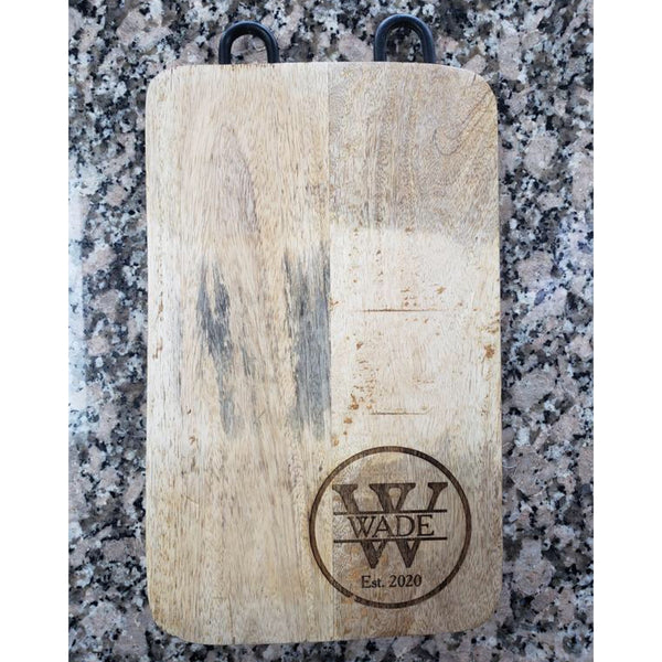 engraved wood cutting board with metal hooks