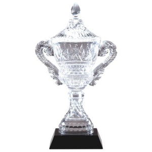 Crystal cup trophy featuring a black square tapered base and an crystal vase with two handles, one on each side. There is a lid and an ornate design throughout.