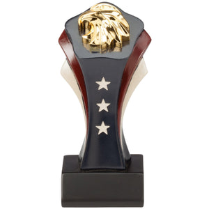 Patriotic trophy featuring a red white and blue small tower with a shiny gold eagle's head on top.