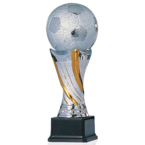 Large shiny silver ceramic trophy featuring a square black wood base, a gold and silver tall pedestal, and a huge silver soccer ball on top.