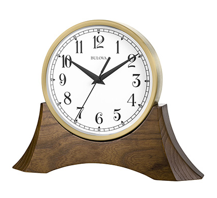 Bulova clock featuring a walnut wood base and a detachable round clock with a white face, and back hands and numbers.