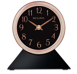 Black wood base with a detachable rose gold and white bushed clock sitting on top. Clock features a black face with rose gold numbers and hands. The rim of the clock is rose gold with an over bush of white for a rustic look.