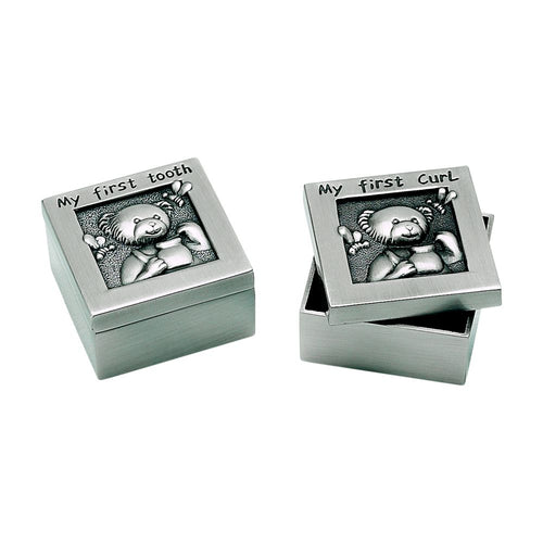 Two small square silver boxes with lids that feature a teddy bear. On the lid of each box reads