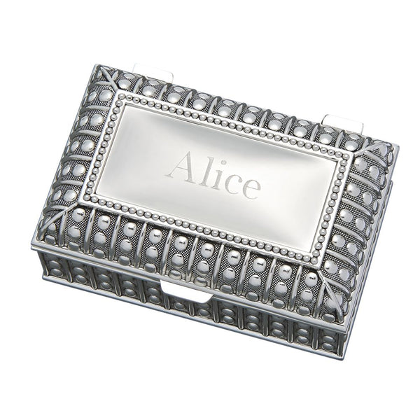Rectangle shaped jewelry box feauturing a beaded design throughout. The top is flat and is engraved with a name.