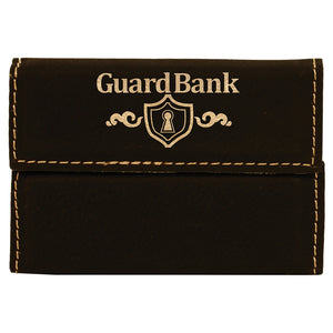 Black with gold engraving leatherette business card holder.