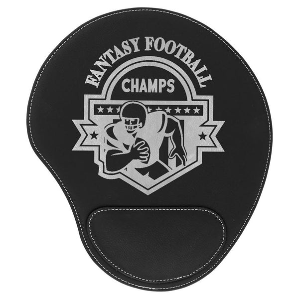 Black leatherette mouse pad with a pad at the bottom to rest your wrist. The mouse pad is engraved with a large silver company logo.