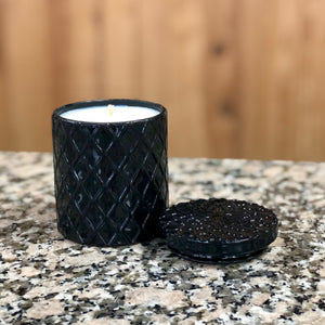 Black glass candle with lid.
