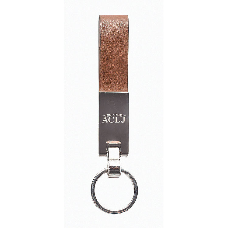 Brown leatherette loop keychain with a silver key ring and accent hooking the two together. The Silver rectangle accent is engraved with a scroll and a monogram.