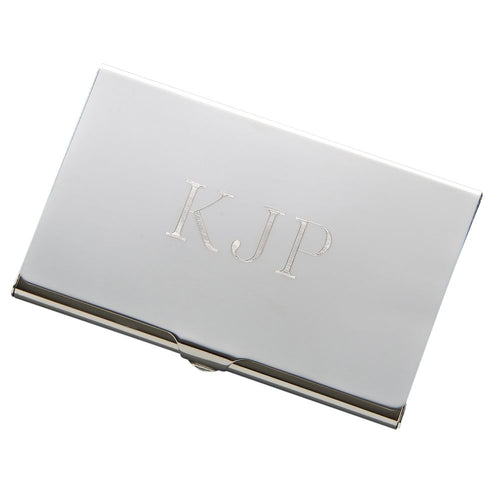 Sleek shiny silver business card holder engraved with monogram in the middle.