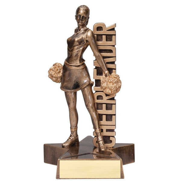 "Bronze cheerleading resin featuring a star shaped base, a cheerleader with pom poms and the word ""CHEERLEADER"" displayed vertically."