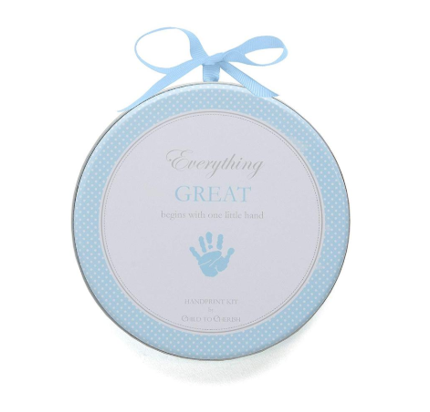 Round blue and white metal tin that contains a baby boy clay hand print kit.