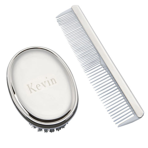 Engraved shiny silver baby brush with no handle and baby comb with white teeth.