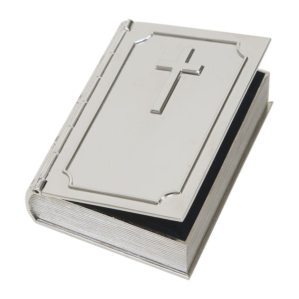 Small silver book shaped keepsake box with a hinged cover. The front of the box features a border, a cross, and a name engraved at the bottom.The edges are designed to look like the spine and pages of a book.