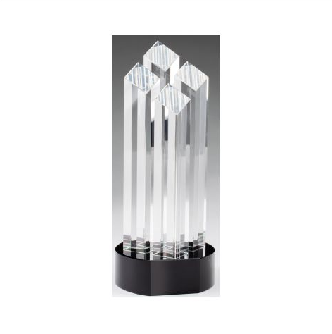 Crystal tower award featuring a round black glass base with room for an engraved plate. the crystal consists of four separate skinny towers with slanted tops.