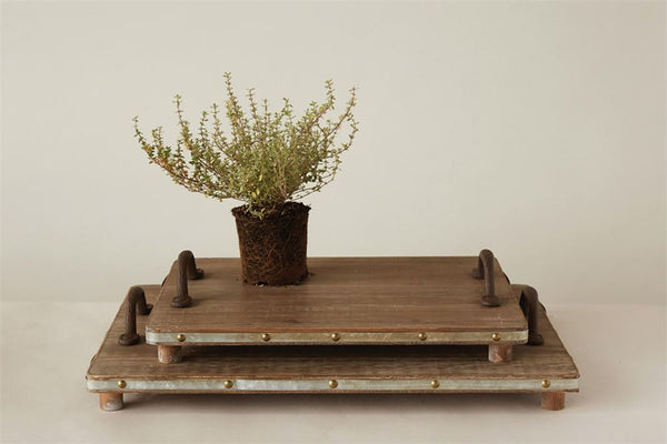 Two flat rectangle wooden trays with wooden feet and iron handles. Large and small sizes are available.
