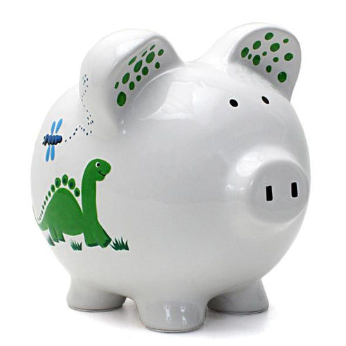 White glass large piggy bank painted with a green dinosaur and blue dinosaur design throughout. Small details such as grass, the sun and dragonflies are included.