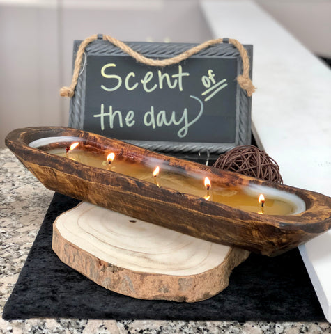 Large hand poured white wax candle in an extra long wooden dough bowl container with five wicks.