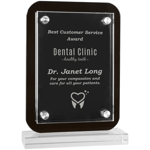 Standing black glass plaque featuring a rectangle shape and rounded edges. The base is clear glass rectangle shaped. There is a clear piece of engraved acrylic overlaid on the glass plaque that is secured by magnets on all four corners.