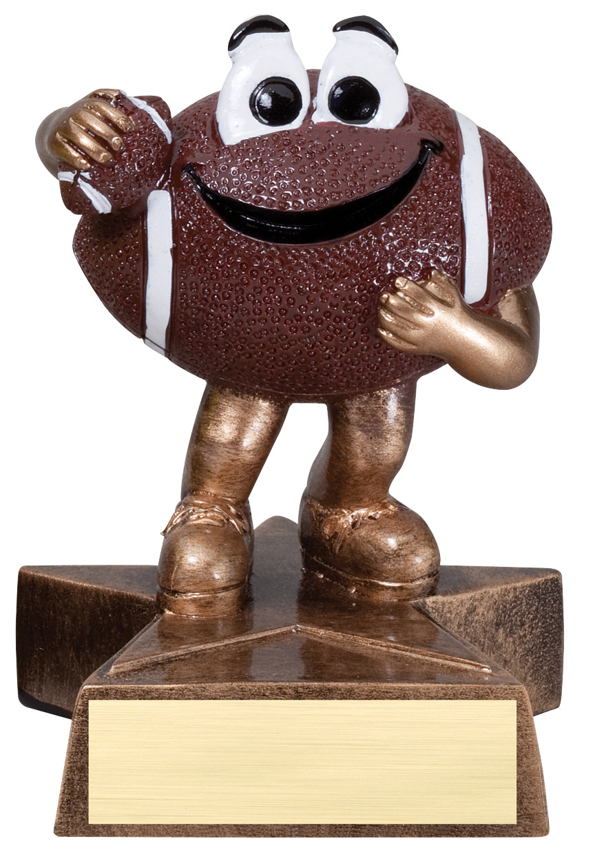 Small football trophy featuring a star shaped base, and a football that has legs, arms and a happy face. He is holding a mini football in one arm.
