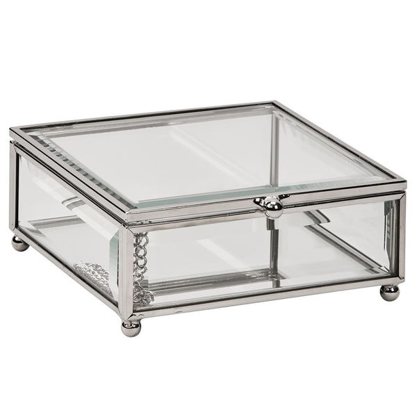 Rectangle shaped glass jewelry box with silver edges and corners and round feet.