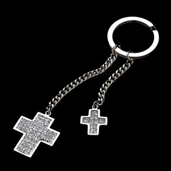 Silver keychain featuring two chains attached to the key ring. One is longer, one is shorter. At the end of each chain hangs a large glitter cross and a small glitter cross.