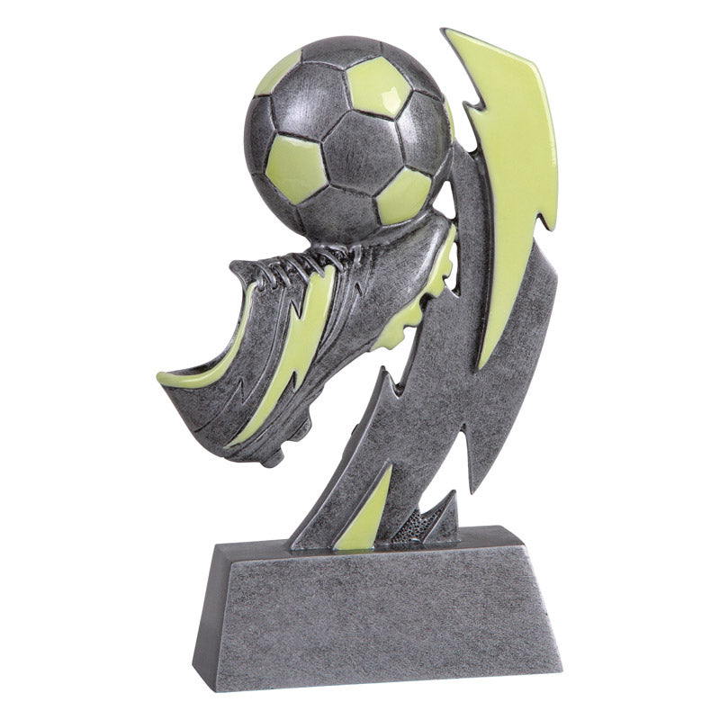 Silver and green glow in the dark soccer trophy featuring a soccer ball, a soccer cleat, and a lightening bolt.
