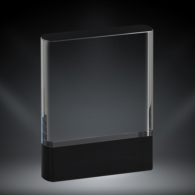 Crystal award featuring rounded edges, a rectangular design, and a thick black strip at the bottom.