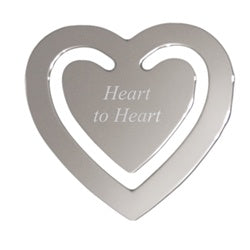 Silver metal heart shaped bookmark. Bookmark is engraved in the center with a special message.