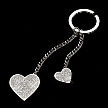 Silver keychain featuring two chains attached to the key ring. One is longer, one is shorter. At the end of each chain hangs a large glitter heart and a small glitter heart.