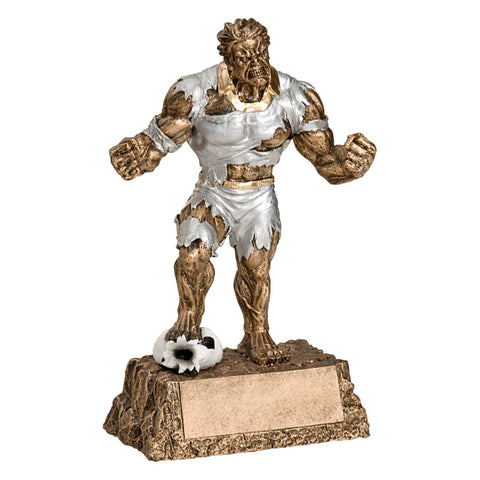 Hulk inspired soccer trophy featuring a bronze rectangle base that resembles rocks, and a bronze monster busting out of ripped silver clothes. He is stepping on a flattened soccer ball with his hands in fists.