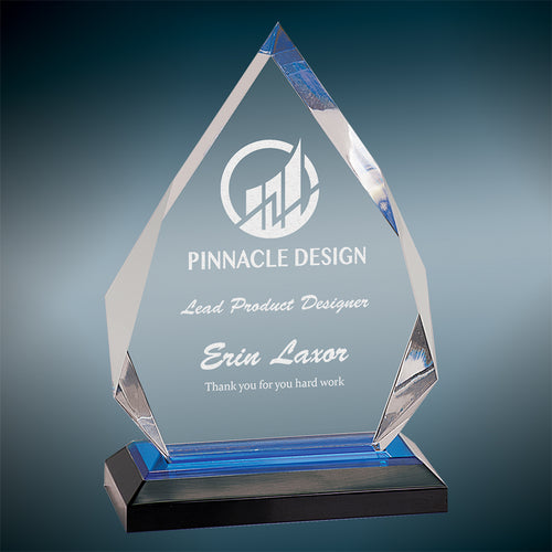 Clear engraved impress diamond shaped acrylic award on a black and blue base.