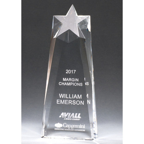 Tall engraved clear crystal award featuring a beveled front that extents to the top of the award to make a star shape. the star is slanted downwards.